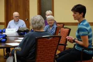 Photo description: Melissa Lage, Physical Therapist, talking with Stepping On participants